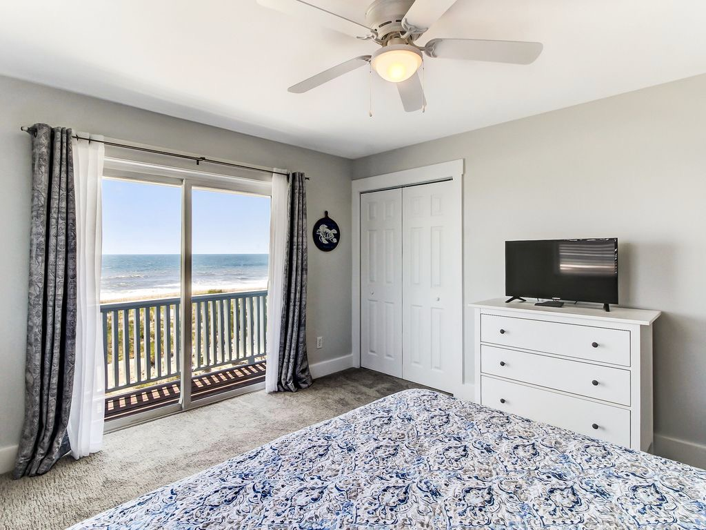 Master bedroom with TV and large closet