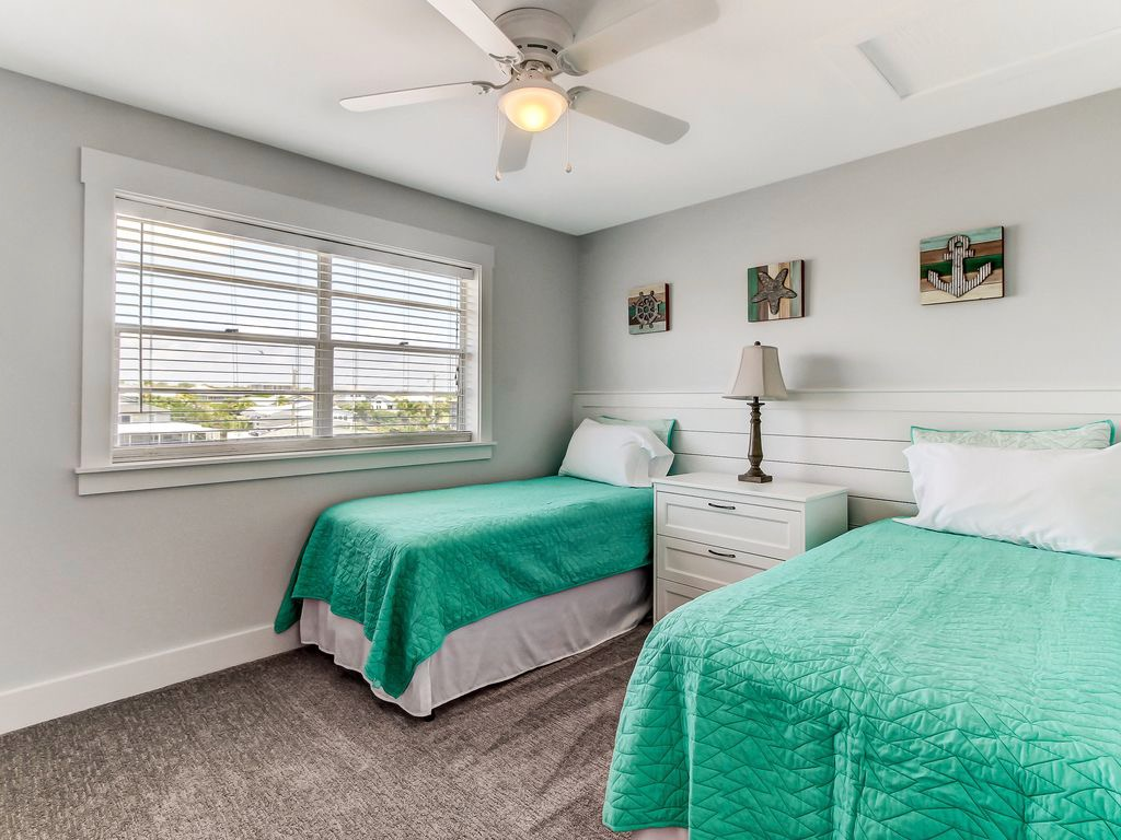 Light and bright twin bedroom.  Beds can be pushed together
