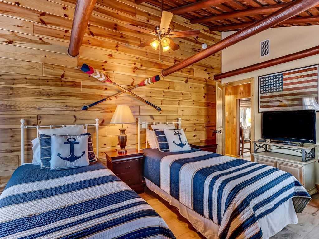 1st Floor twin bedroom with en suite bathroom with vanity an