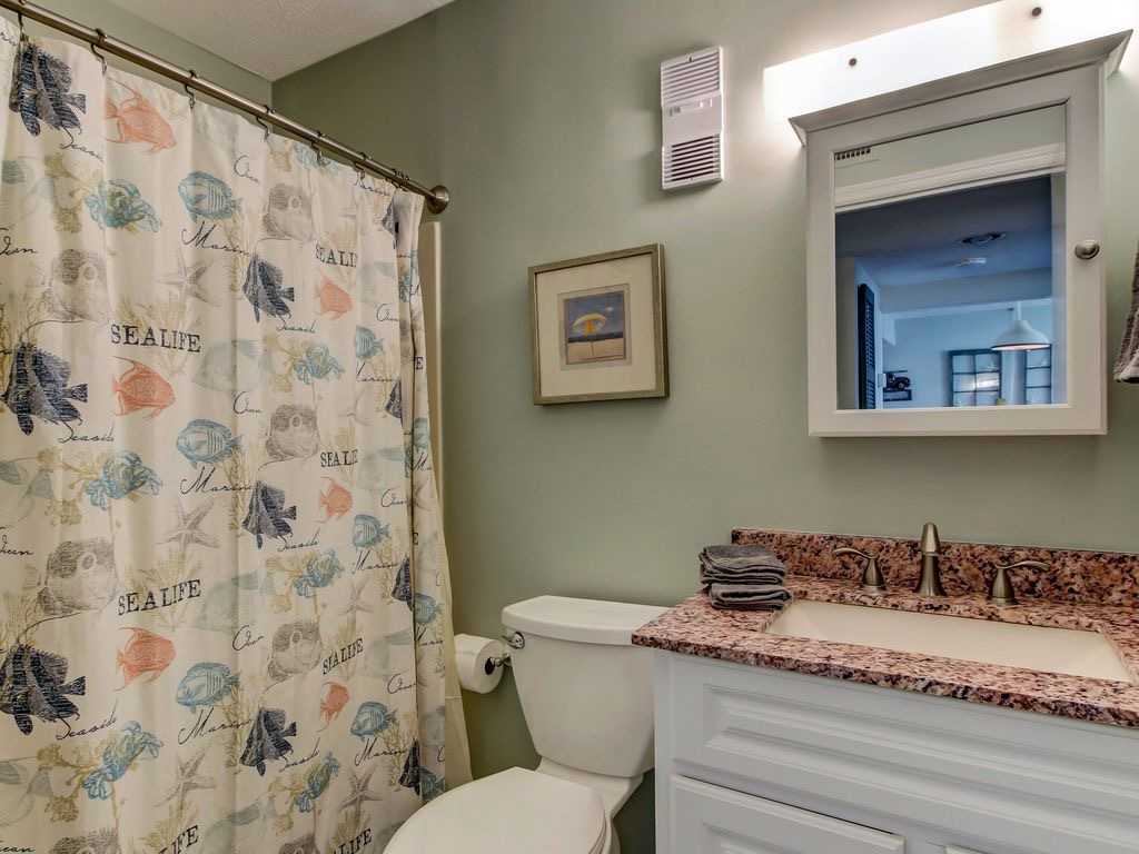 Hallway bathroom with vanityh and tub/shower combination