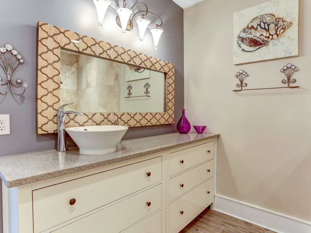 Master bathroom with his/hers vanities, walk-in shower and s