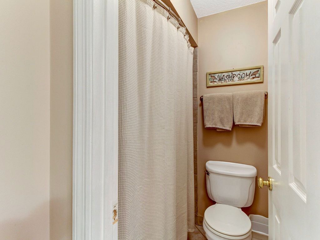 Separate bathroom with walk-in shower
