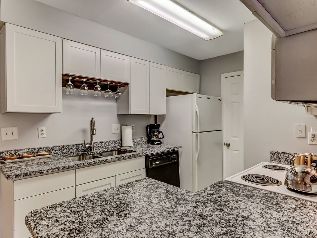 Bright kitchen with granite countertops