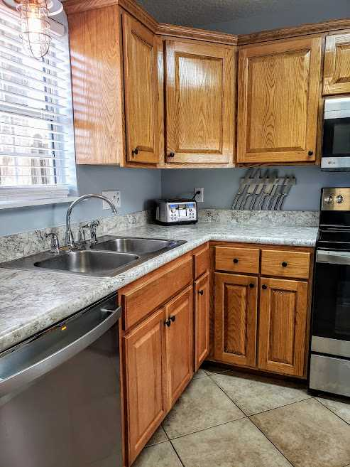 Well stocked kitchen with new stainless steel appliances
