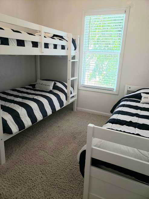 Twin bunk beds with additional twin bed