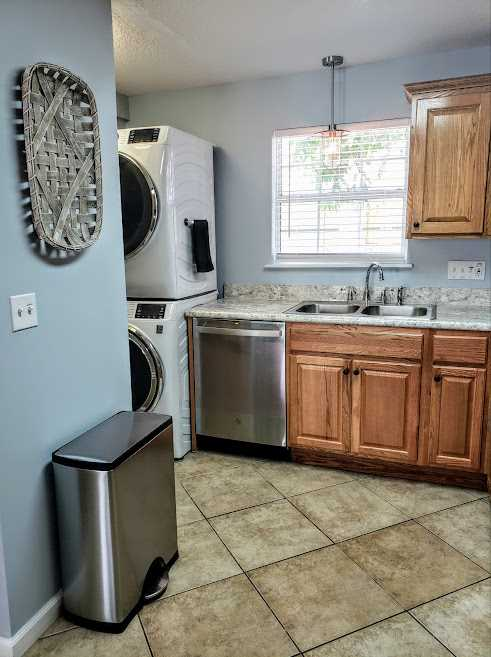 Laundry area with stacked washer/dryer