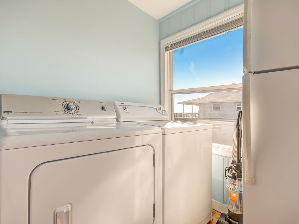 Laundry area conveniently located near kitchen with one more