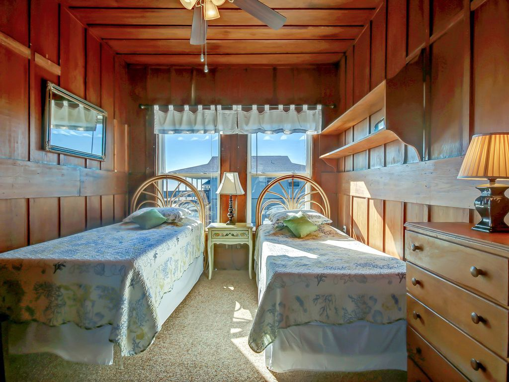Twin beds with the sound of ocean waves to lull you to sleep