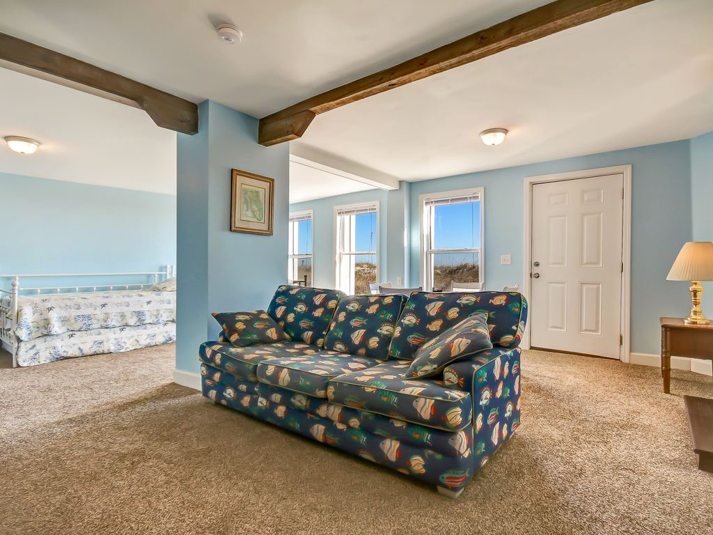 Bonus room includes a table with seating for four, daybeds,