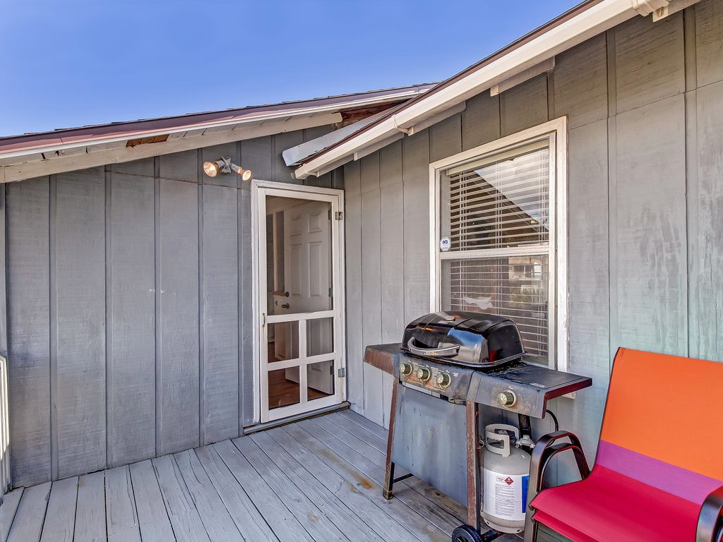 Cute porch at the back of the house with gas grill!