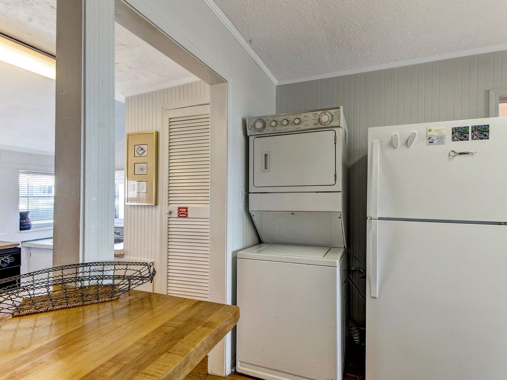 Stacked washer/dryer and refrigerator