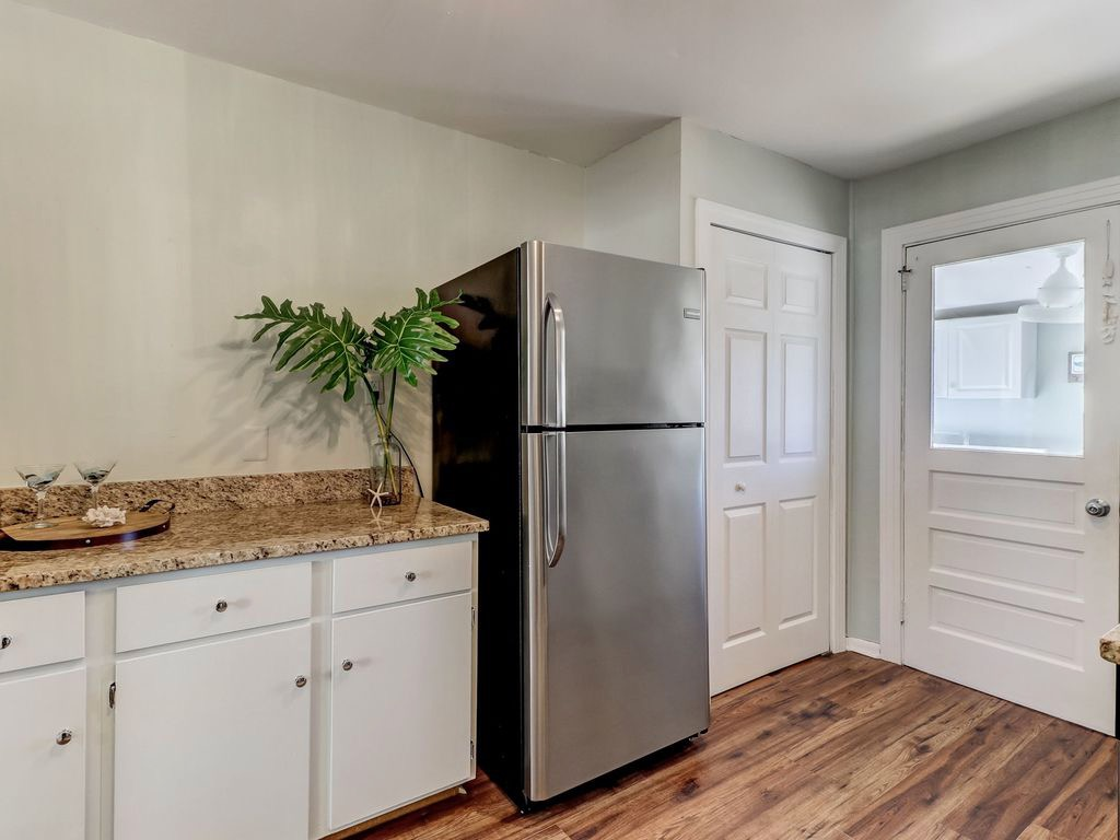 Kitchen with pantry and door leading to laundry room and ent