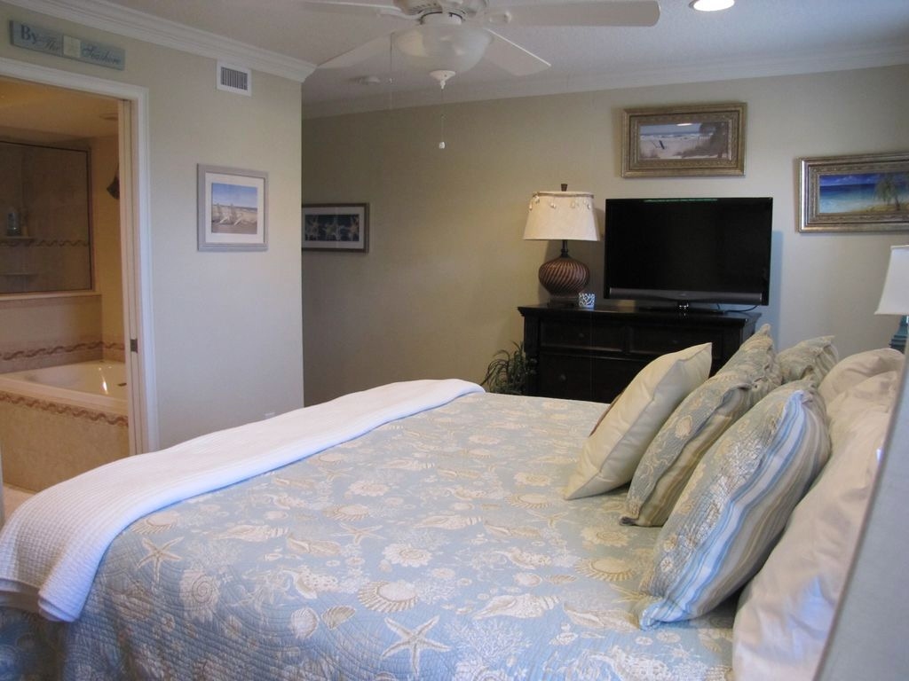 Another view of downstairs bedroom with flat screen TV