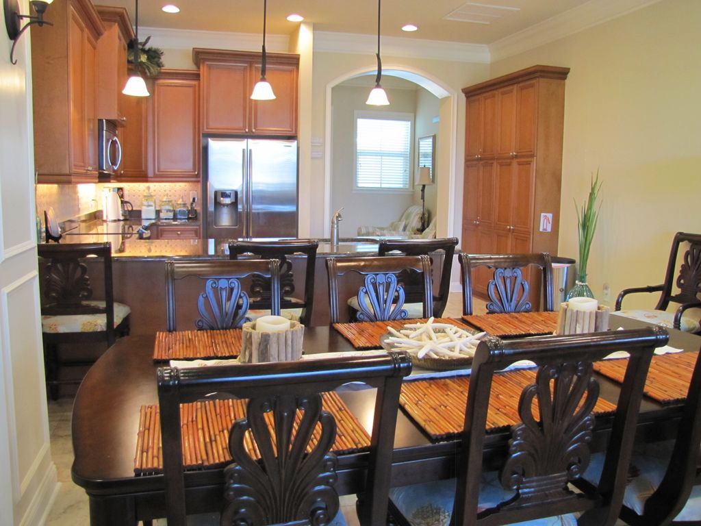 Lovely dining area and view of kitchen with cozy area at top