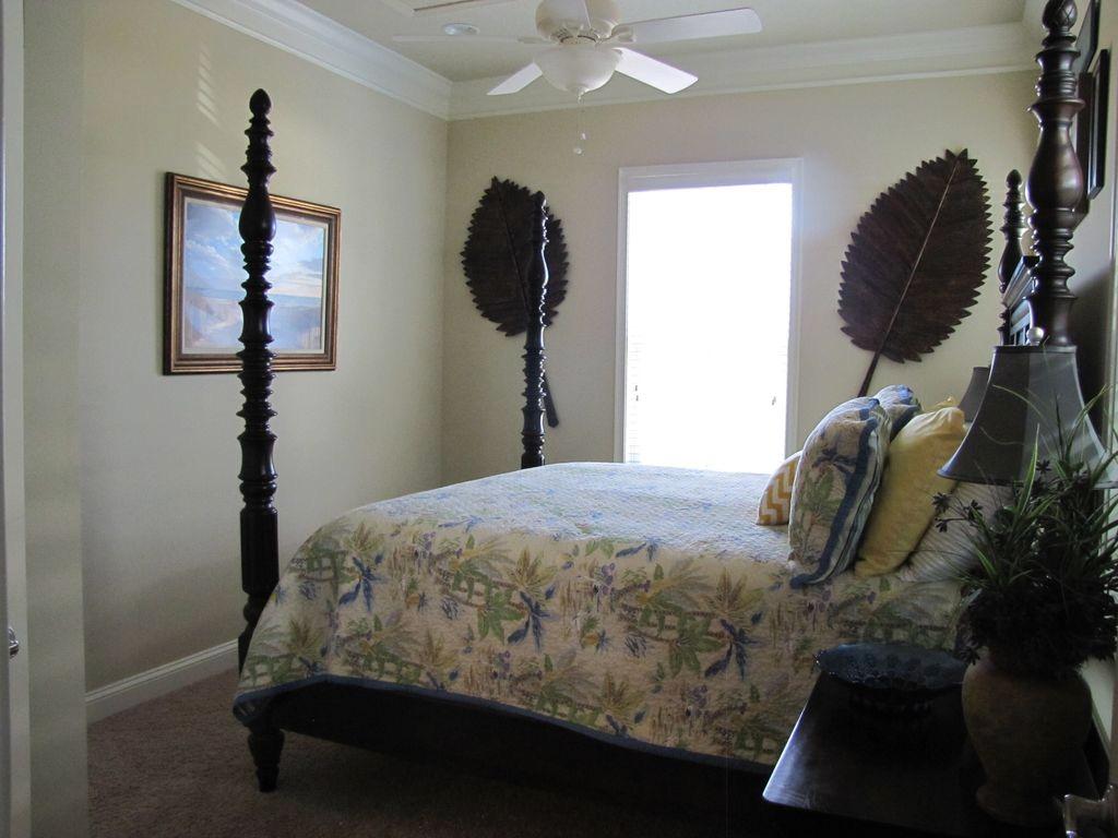 2nd Floor master bedroom with king bed and bathroom en suite